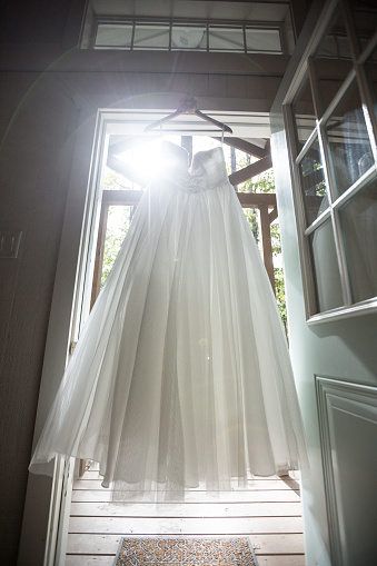 Dress「Wedding dress hanging in doorway」:スマホ壁紙(9)