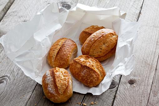 Bun - Bread「Five bread rolls on paper and grey wood」:スマホ壁紙(11)