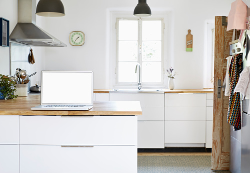 Kitchen Counter「Laptop standing on worktop in a modern kitchen」:スマホ壁紙(14)