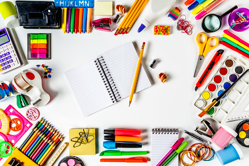 Pen「Overhead shot of back to school office supplies on white background with paper note book into frame.」:スマホ壁紙(18)