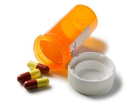 Antibiotic「Open bottle of prescription drugs isolated on white background」:スマホ壁紙(9)