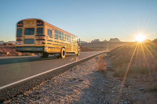 Indigenous Culture「School bus on highway at sunset in nature」:スマホ壁紙(0)