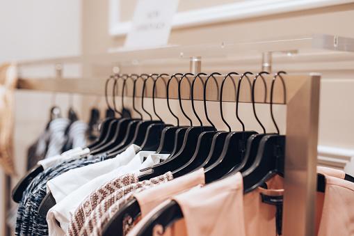 Merchandise「Dresses hanged in a clothing store」:スマホ壁紙(16)