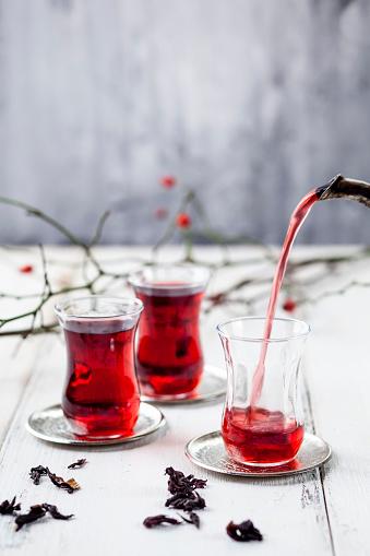 Ice Tea「Pouring hollyhock tea in tea glass」:スマホ壁紙(1)
