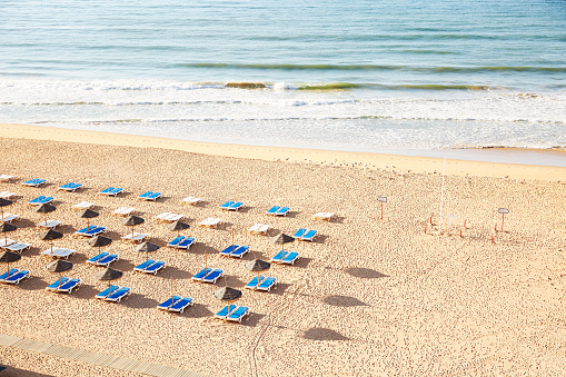 Beach「Bright blue sun beds on empty beach」:スマホ壁紙(13)