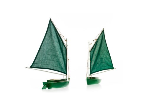 Sailboat「Two toy boats on white background」:スマホ壁紙(15)