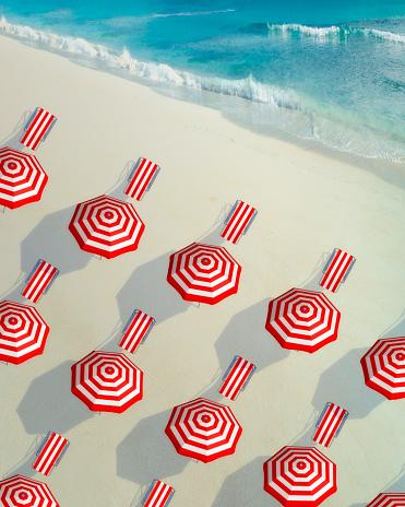 Sunbathing「Deckchairs and sunshades in a raw at beach」:スマホ壁紙(10)