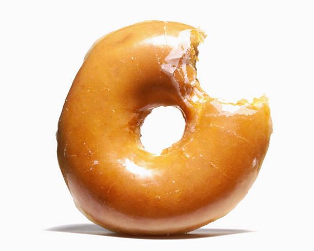 Glazed doughnut with missing bite:スマホ壁紙(壁紙.com)