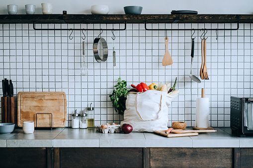 Ecosystem「A reusable bag full of colourful and fresh organic vegetables and groceries on the kitchen counter. Zero waste shopping and sustainable lifestyle concept」:スマホ壁紙(6)