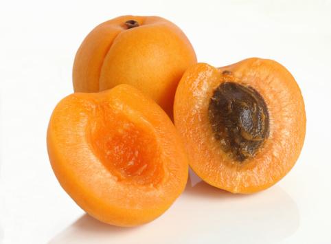 Apricot「Two fresh apricots, one cut in half.」:スマホ壁紙(18)