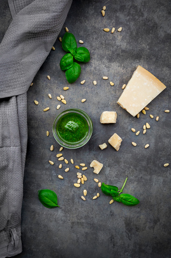 Pine Nut「Glass of homemade pesto Genovese, pine nuts, basil leaves and parmesan on grey ground」:スマホ壁紙(0)