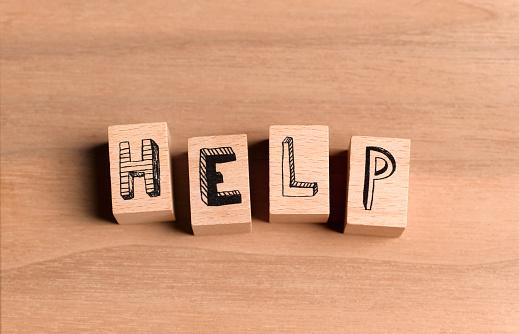 A Helping Hand「Wooden bricks spelling the word help」:スマホ壁紙(3)