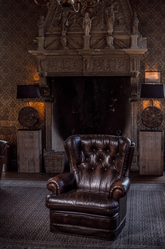 Chesterfield Sofa「An elegant chair in a stately home living room」:スマホ壁紙(5)