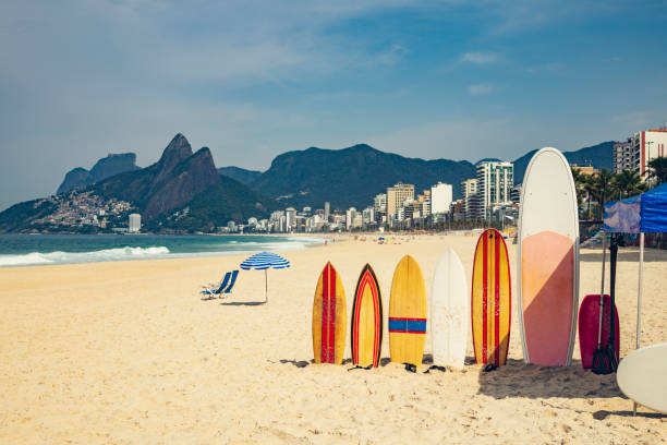Ipanema beach  with surfboards and parasol:スマホ壁紙(壁紙.com)