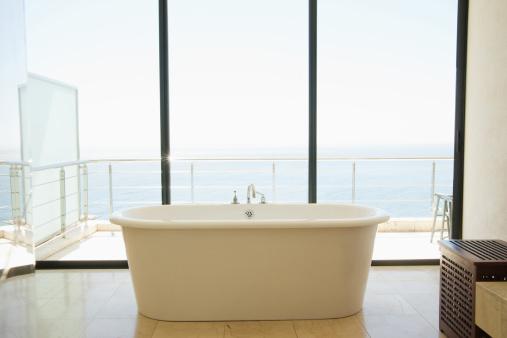 Indulgence「Modern bathroom with bathtub and large windows」:スマホ壁紙(16)