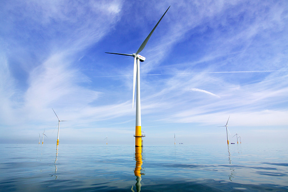 Turbine「view of the Kentish flats offshore windfarm showing the wind turbine generators off whitstable and herne bay in kent on a calm windless day with reflections in the water」:写真・画像(4)[壁紙.com]