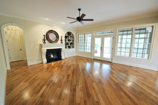 Ceiling Fan「A stylish living space with polished wooden floors can」:スマホ壁紙(9)