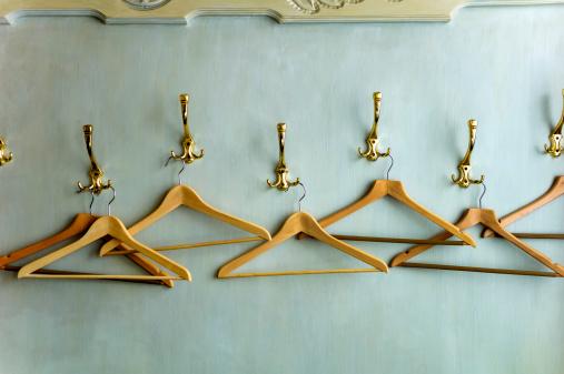 Austria「Wood coathangers in wardrobe, close up」:スマホ壁紙(12)