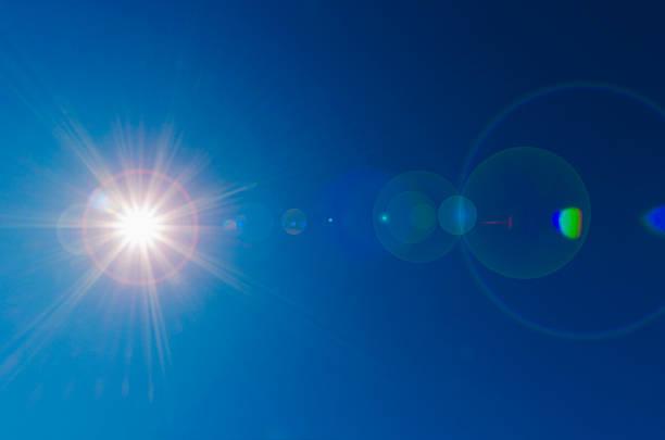Blue sky with solar flare:スマホ壁紙(壁紙.com)