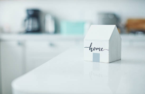 Little wooden home in bright white kitchen. New home concept.:スマホ壁紙(壁紙.com)