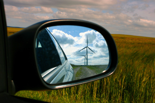 Wind Turbine「Windmill reflected in car wing mirror with view of fields.」:スマホ壁紙(0)