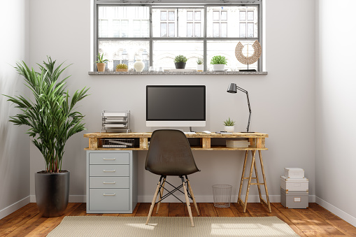Home Office「Home Office Interior With A Wooden Table And Blank Screen Monitor」:スマホ壁紙(17)
