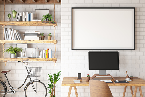 Small Office「Home Office Concept with Computer and Blank Picture Frame」:スマホ壁紙(7)