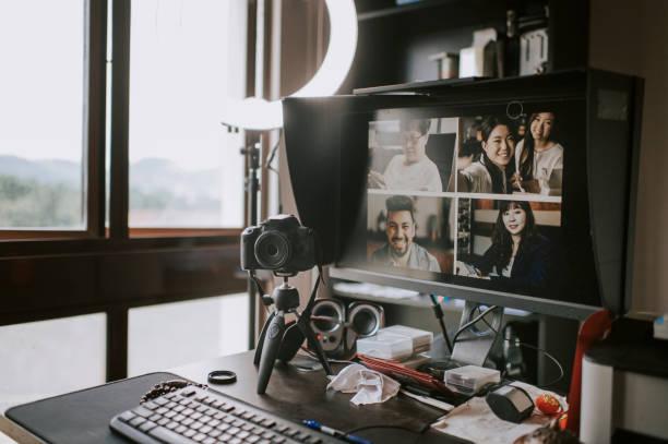 home office setup for vblogging / online blogging e - learning with computer desktop PC, keyboard, computer mouse, monitor scree, Bluetooth speaker, DSLR camera with tripod beside window:スマホ壁紙(壁紙.com)