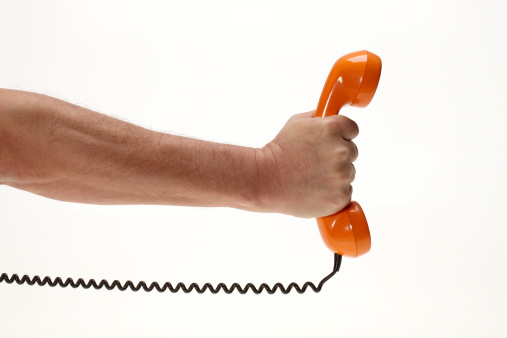 Human Hand「Male arm presenting vintag orange phone」:スマホ壁紙(10)