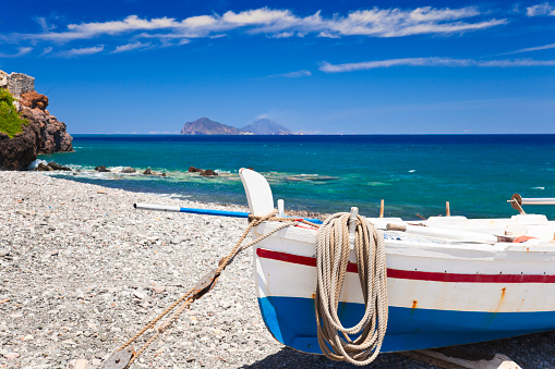 Aeolian Islands「A boat on the shore of the Mediterranean」:スマホ壁紙(11)