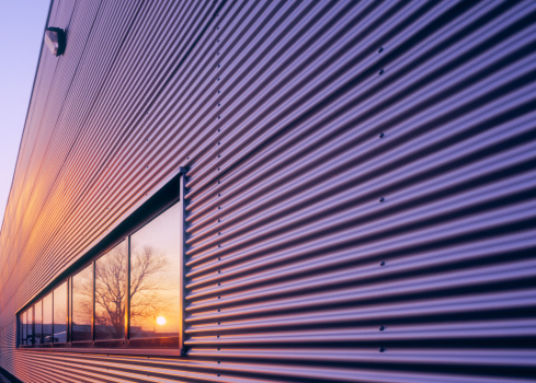 Corrugated Iron「Sunset reflecting in window of warehouse.」:スマホ壁紙(1)