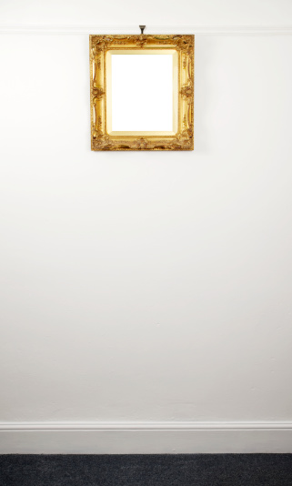 Gold Leaf「Gold Ornate Picture Frame Hanging From Rail On Wall」:スマホ壁紙(16)