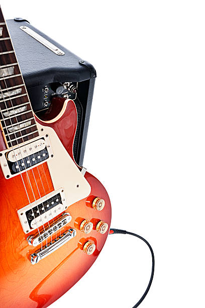 Electric guitar leaning on amplifier:スマホ壁紙(壁紙.com)