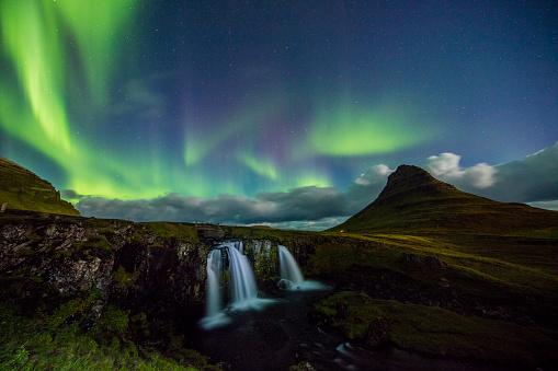 star sky「Scenic view of Aurora Borealis over waterfall」:スマホ壁紙(2)