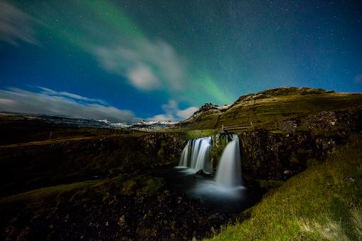 star sky「Scenic view of Aurora Borealis over waterfall」:スマホ壁紙(1)
