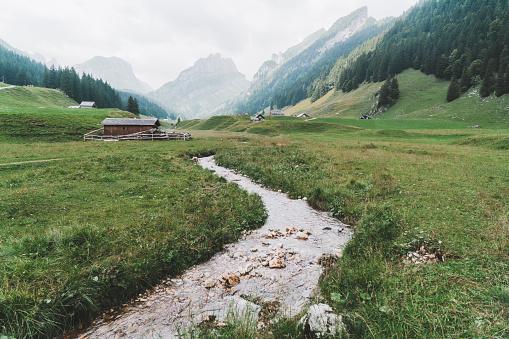 Rolling Landscape「Scenic view of river in  mountains in Switzerland」:スマホ壁紙(14)