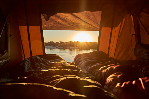 Caprivi Strip「Scenic view of river seen from tent at Caprivi Strip during sunset, Namibia」:スマホ壁紙(3)
