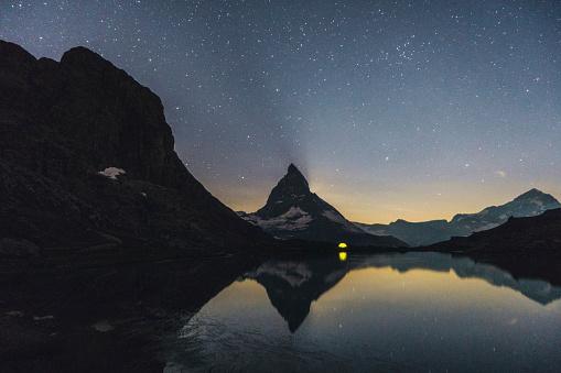 Pennine Alps「Scenic view of lake near  Matterhorn mountain and starry sky above it」:スマホ壁紙(4)