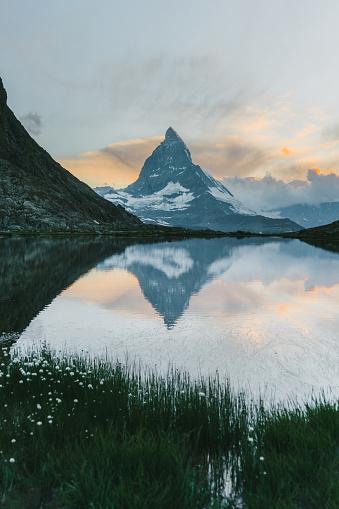 Pennine Alps「Scenic view of lake near  Matterhorn at sunset」:スマホ壁紙(7)