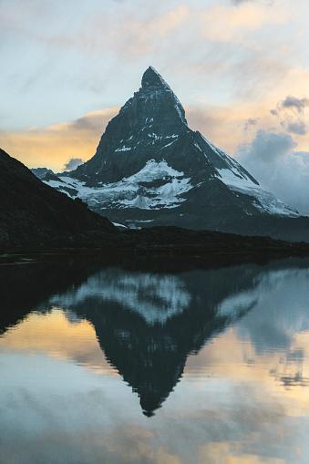 Pennine Alps「Scenic view of lake near  Matterhorn at sunset」:スマホ壁紙(5)