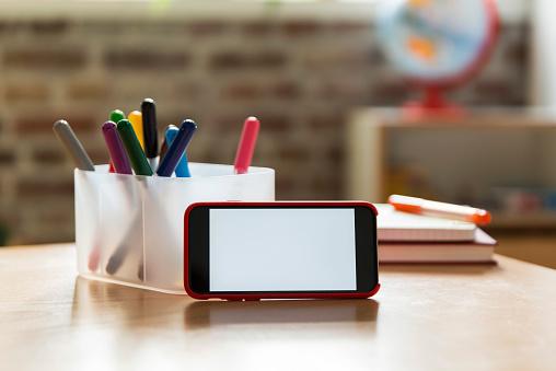 Mobile Phone「Smartphone on wooden table in children's room」:スマホ壁紙(3)