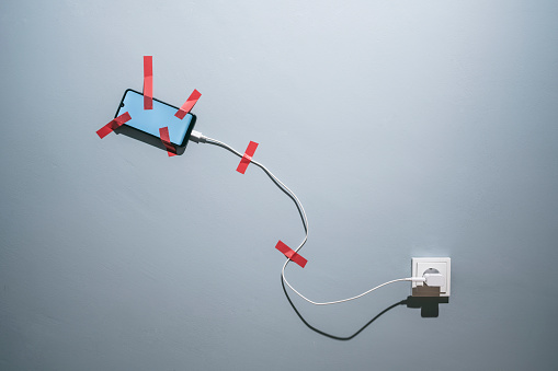 Touch Screen「Smartphone attached to a wall with adhesive tape」:スマホ壁紙(8)