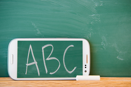 Chalk - Art Equipment「Smartphone leaning against chalkboard with ABC letters displayed」:スマホ壁紙(17)