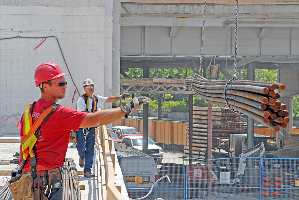 Construction Equipment「steel workers, unoading of rebar, from crane, PCL Contractors; Conference Centre; Congress Centre job site; in progress; demolition; rebuild; Ottawa; Ontario Canada」:写真・画像(4)[壁紙.com]