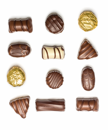 Milk Chocolate「Assorted chocolates laid individually on white background」:スマホ壁紙(0)