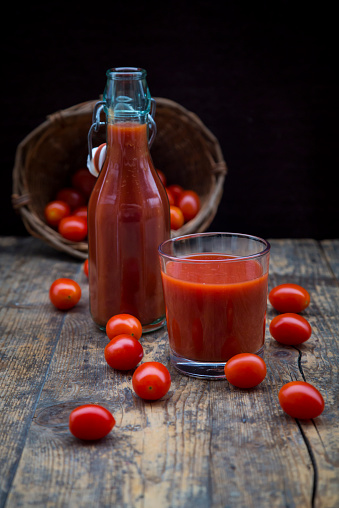 Vegetable Juice「Glass and bottle of tomato juice and tomatoes」:スマホ壁紙(1)