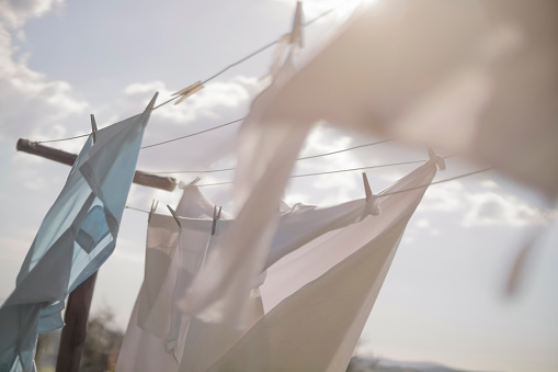 Clothespin「Laundry hanging on clothesline in sunlight」:スマホ壁紙(15)