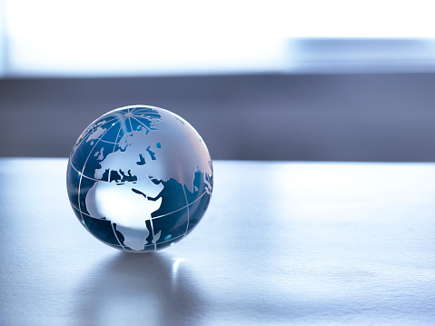 Planet Earth「Global Markets, A glass globe illustrating the world on a desk.」:スマホ壁紙(10)
