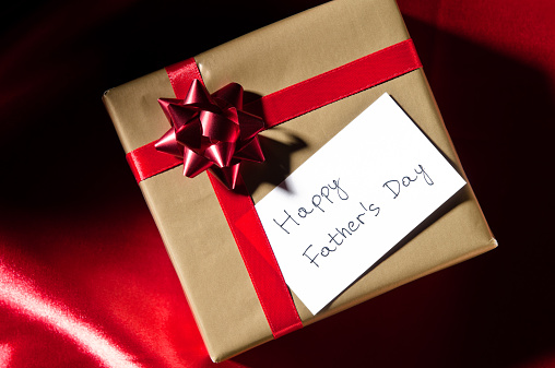 Father's Day「Happy Father's Day, gift with red ribbon against red background」:スマホ壁紙(16)
