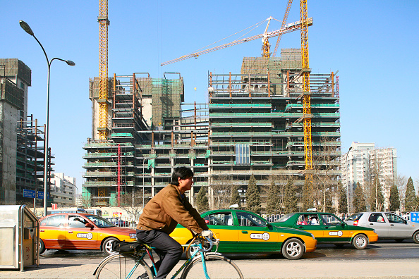 Economy「A new office block under construction on the second ring road at Dongzhimen in central Beijing.」:写真・画像(16)[壁紙.com]